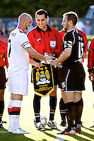 Manchester City's Stephen Ireland and Portland Timbers' Ian Joy exchange flags before  a match at Merlo Field in Portland Oregon on July 17, 2010.
