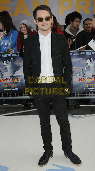 Elijah Wood.European Premiere of 'Happy Feet Two' at the Empire Leicester Square, London, England..November 20th 2011.2 full length suit black suit jacket white shirt sunglasses shades stubble facial hair .CAP/CAN.©Can Nguyen/Capital Pictures.
