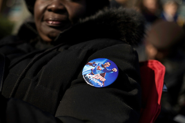 """March 26, 2008. Greensboro, NC.. US Senator  Barack Obama continued his campaign for the presidency with a """"town hall"""" style rally, where he spoke for approximately 20 minutes and then spent almost an hour answering questions from the crowd.. A """"Super Obama"""" pin worn by Linda Monroe."""