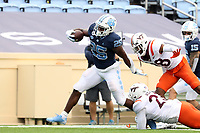 CHAPEL HILL, NC - OCTOBER 10: Javonte Williams #25 of North Carolina breaks a tackle by Rayshard Ashby #23 of Virginia Tech on his 19-yard touchdown run during a game between Virginia Tech and North Carolina at Kenan Memorial Stadium on October 10, 2020 in Chapel Hill, North Carolina.