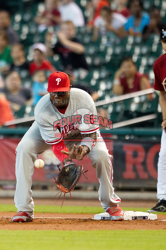 Philadelphia Phillies first baseman Ryan Howard #6 receives a throw at first during the Major League baseball game against the Houston Astros on September 16th, 2012 at Minute Maid Park in Houston, Texas. The Astros defeated the Phillies 7-6. (Andrew Woolley/Four Seam Images)..