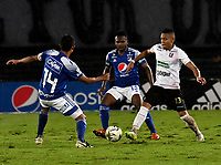 BOGOTA - COLOMBIA, 27-11-2020: David Macalister Silva, Elvis Perlaza de Millonarios F. C. y Carlos Pajaro de Once Caldas disputan el balon, durante partido entre Millonarios F. C. y Once Caldas de la fecha 1 por la Liguilla BetPlay DIMAYOR 2020 jugado en el estadio Nemesio Camacho El Campin de la ciudad de Bogota. / David Macalister Silva, Elvis Perlaza of Millonarios F. C. and Carlos Pajaro of Once Caldas figth for the ball, during a match between Millonarios F. C. and Once Caldas of the 1st date for the BetPlay DIMAYOR 2020 Liguilla played at the Nemesio Camacho El Campin Stadium in Bogota city. / Photo: VizzorImage / Luis Ramirez / Staff.