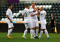 Andy Robinson of Swansea (R) celebrates his goal with team mates (L-R) Ferrie Bodde, Lee Trundle and Alan Tate. during the Swansea Legends v Manchester United Legends at The Liberty Stadium, Swansea, Wales, UK. Wednesday 09 August 2017