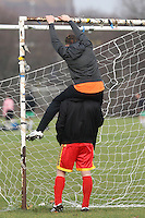 Vio Romania FC players put up the goal net before their Hackney & Leyton League match on at Hackney Marshes - 24/01/10 - MANDATORY CREDIT: Gavin Ellis/TGSPHOTO - Self billing applies where appropriate - Tel: 0845 094 6026