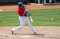 Round Rock Express third baseman Mike Olt #20 swings the bat against the Omaha Storm Chasers in the Pacific Coast League baseball game on April 7, 2013 at the Dell Diamond in Round Rock, Texas. Omaha beat Round Rock 5-2, handing the Express their first loss of the season. (Andrew Woolley/Four Seam Images).