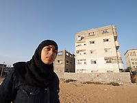 """Amira Al-Qerem (16) visits her old neighbourhood in Gaza City on October 27 2010. Amira was missing and presumed dead after she was injured by one of the same explosions that killed her father, brother and sister during the last days of the Israeli invasion of Gaza in 2009. She was found three days later, after her family thought they had buried her remains with those of the other three. She is one of the main subjects of the controversial documentary film """"Tears of Gaza"""" by director Vibeke Løkkeberg."""