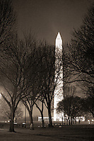 Washington Monument  Washington DC<br /> The Washington Monument, a Washington D.C. landmark , is a large obelisk near the west end of the National Mall.  It is a United States Presidential Memorial constructed to commemorate the first U.S. president, George Washington. The monument, made of marble, granite, and sandstone, is both the world's tallest stone structure and the world's tallest obelisk.  A national icon and popular tourist attraction in Washington DC.