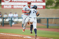 Greeneville Reds first baseman Raul Juarez (39) collides with Nelson Gomez (14) of the Pulaski Yankees as he reaches for a wide throw at Calfee Park on June 23, 2018 in Pulaski, Virginia. The Reds defeated the Yankees 6-5.  (Brian Westerholt/Four Seam Images)