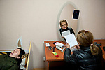 Tanya, Scharfschuetzin der pro-russischen Separatisten, Portrait, Donezk, Ukraine, 10.2014,  Tanya (19), the spearatist's sniper rests on his bed while her friend Natasha, an chief at the separatist's canteen reads Tanya's letter to her commander where she asks him to get released from her unit. Tanya is not satisfied wiht her position, wants to go to frontline to fight and not to be a sniper who just supports a unit of mortars.  ***HIGHRES AUF ANFRAGE*** ***VOE NUR NACH RUECKSPRACHE***