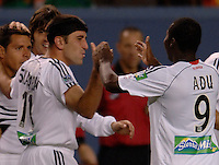DC United midfielder (11) Alecko Eskandarian (third from left) is congratulated by teammates Christian Gomez, Facundo Erpen and (9) Freddy Adu after scoring the game's opening goal. The Colorado Rapids beat DC United 2-1 at Invesco Field at Mile High Stadium, Denver, Co. May 5, 2006.