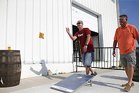 Dan Kelsey of Rogers (from left) and Mark Stadie of Rogers play corn hole, Friday, July 23, 2021 at Ozark Beer Company in Rogers. They expanded their patio area and added to their capacity. The brewery is in downtown Rogers and was the second largest beer producer in the state in 2019. Check out nwaonline.com/210724Daily/ for today's photo gallery. <br /> (NWA Democrat-Gazette/Charlie Kaijo)