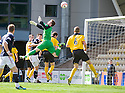LIVY KEEPER ANDREW NEIL FUMBLES THE BALL INTO HIS OWN NET FOR DUNDEE'S SECOND