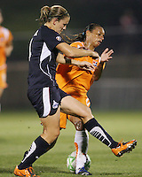 Cat Whitehill#4 of the Washington Freedom knocks the ball clear of Rosana#11 of Sky Blue FC during a WPS match at Maryland Soccerplex on August 8,2009 in Boyds, Maryland. Freedom won 3-1