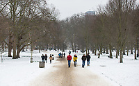 People walk towards Green Park tube station in icy conditions in Snow in London as Beast from the East weather continues at City of London, London, England on 1 March 2018. Photo by Andy Rowland.
