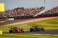 16 LECLERC Charles (mco), Scuderia Ferrari SF21, action 05 VETTEL Sebastian (ger), Aston Martin F1 AMR21, action during the Formula 1 Pirelli British Grand Prix 2021, 10th round of the 2021 FIA Formula One World Championship from July 16 to 18, 2021 on the Silverstone Circuit, in Silverstone, United Kingdom - <br /> Formula 1 GP Great Britain Silverstone 16/07/2021<br /> Photo DPPI/Panoramic/Insidefoto <br /> ITALY ONLY