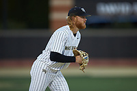 Wake Forest Demon Deacons third baseman William Simoneit (8) on defense against the Louisville Cardinals at David F. Couch Ballpark on March 6, 2020 in  Winston-Salem, North Carolina. The Cardinals defeated the Demon Deacons 4-1. (Brian Westerholt/Four Seam Images)