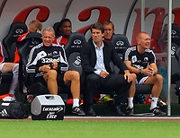 FAO SPORTS PICTURE DESK<br /> Pictured: Michael Laudrup manager for Swansea (C) with coaches Alan Curtis (L) and Adrian Tucker (R). Saturday 25 August 2012<br /> Re: Barclay's Premier League Swansea City FC v West Ham at the Liberty Stadium, south Wales.