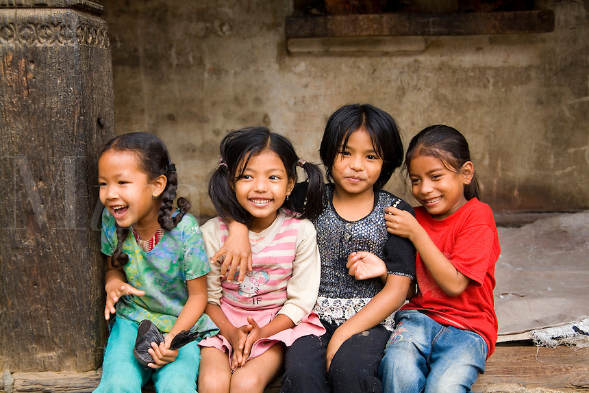 Young children laughing aged 6 and 7 Village of Bhaktapur, a town near Kathmandu, Nepal