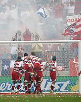 FC Dallas players, Roberto Mina (9), Chris Gbandi (4), Simo Valakari (17), and Mark Wilson (15) pile on Kenny Cooper after Cooper's goal at Pizza Hut Park on Sunday April 23, 2006. Dallas beat Kansas City 2-1.