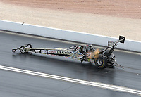 Apr. 7, 2013; Las Vegas, NV, USA: NHRA the chassis is really arched for top fuel dragster driver Brittany Force on her way to her first National Event round win during the Summitracing.com Nationals at the Strip at Las Vegas Motor Speedway. Mandatory Credit: Mark J. Rebilas-