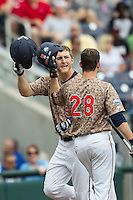 Virginia Cavaliers outfielder Joe McCarthy (31) is greeted after his second inning home run against the Arkansas Razorbacks in Game 1 of the NCAA College World Series on June 13, 2015 at TD Ameritrade Park in Omaha, Nebraska. Virginia defeated Arkansas 5-3. (Andrew Woolley/Four Seam Images)
