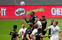 LOS ANGELES, CA - OCTOBER 25: Jesus David Murillo #94 of LAFC heads a ball during a game between Los Angeles Galaxy and Los Angeles FC at Banc of California Stadium on October 25, 2020 in Los Angeles, California.