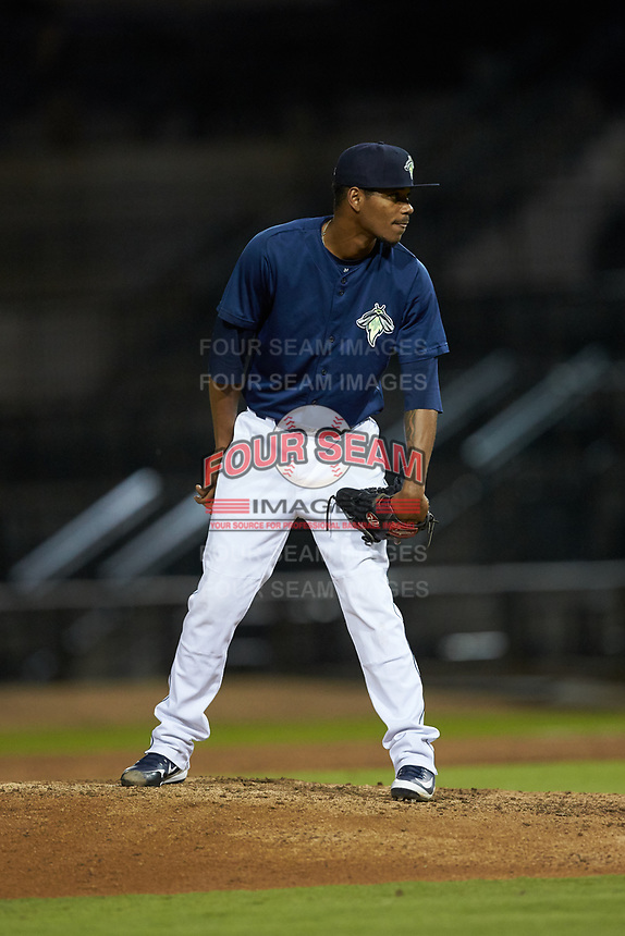 Columbia Fireflies relief pitcher Jose Moreno (26) looks to his catcher for the sign against the Rome Braves at Segra Park on May 13, 2019 in Columbia, South Carolina. The Fireflies defeated the Braves 6-1 in game two of a doubleheader. (Brian Westerholt/Four Seam Images)