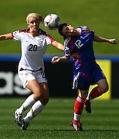 Marine Augis (FRA) gets to the ball ahead of Olivia Klei (USA)..FIFA U17 Women's World Cup, USA v France, Albany Stadium, Auckland, New Zealand, Wednesday 5 November 2008. Photo: Renee McKay/PHOTOSPORT