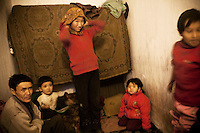 Gulmira and Joldoshbek live with their three children in a small room with no windows situated in an old disused brick factory. They moved a few years ago from Naryn in search of work, but only Gulmira could find a job. His salary is not enough to feed the whole family..