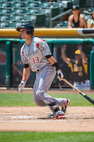 Dustin Garneau (13) of the Albuquerque Isotopes at bat against the Salt Lake Bees in Pacific Coast League action at Smith's Ballpark on June 28, 2015 in Salt Lake City, Utah.The Isotopes defeated the Bees 8-3. (Stephen Smith/Four Seam Images)