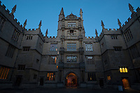 Oxford University's Bodleian Library, with the tower of the five orders, at dusk.