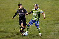 COLUMBUS, OH - DECEMBER 12: Lucas Zelarayan #10 of Columbus Crew battles for the ball against Raul Ruidiaz #9 of Seattle Sounders FC during a game between Seattle Sounders FC and Columbus Crew at MAPFRE Stadium on December 12, 2020 in Columbus, Ohio.