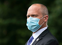 A Secret Service agent wears a mask as he watches President Donald Trump and First Lady Melania Trump depart the White House in Washington, DC on Wednesday, May 27, 2020. President Trump and the First Lady are traveling to NASA's Kennedy Space Center to watch the SpaceX Mission 2 launch. <br /> Credit: Kevin Dietsch / Pool via CNP/AdMedia