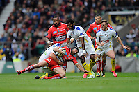 Matt Giteau of RC Toulon is brought down by Jonathan Davies of ASM Clermont Auvergne