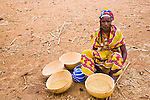 A woman in the small Fulani village of Bele Kwara, Niger separates millet seed from chaff.  She will then pound the millet, and cook the flour to make a millet polenta.  Niger consistently suffers from drought and famine and has one of the highest infant and child mortality rates in the world.