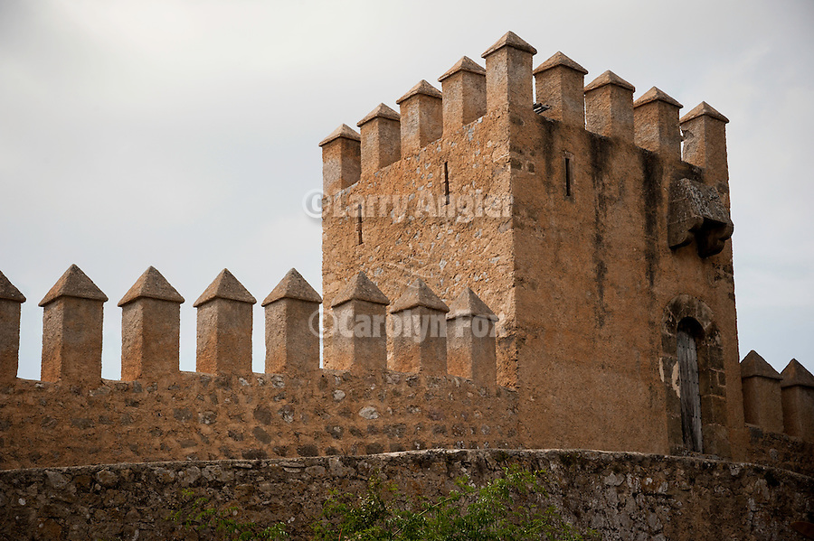 Fortress walls surrounding Sant Salvador church within the ancient hilltop fortress, Arta, Mallorca, Spain...Built in 1812.