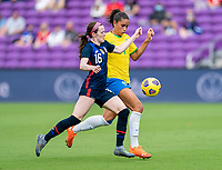 ORLANDO, FL - FEBRUARY 21: Rose Lavelle #16 of the USWNT fights for the ball with Rafaelle #4 of Brazil during a game between Brazil and USWNT at Exploria Stadium on February 21, 2021 in Orlando, Florida.