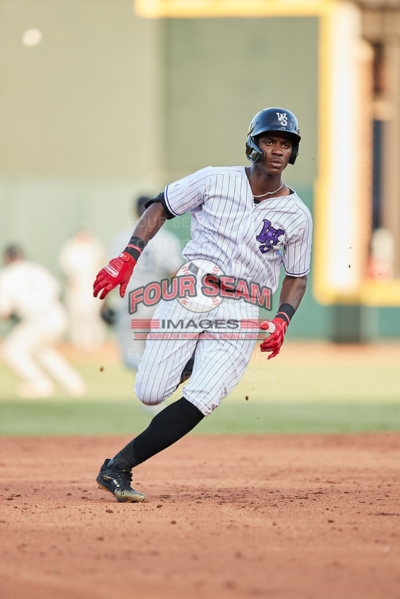 Luis Mieses (13) of the Winston-Salem Dash hustles towards third base against the Hudson Valley Renegades at Truist Stadium on August 28, 2021 in Winston-Salem, North Carolina. (Brian Westerholt/Four Seam Images)