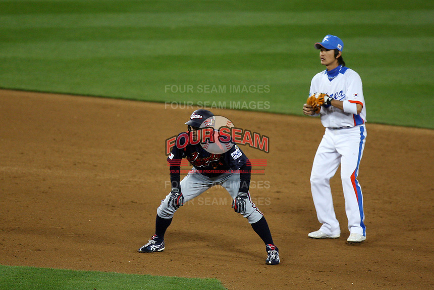 Ichiro Suzuki of Japan and Ki Hyuk Park of Korea during the World Baseball Classic at Dodger Stadium on March 23, 2009 in Los Angeles, California. (Larry Goren/Four Seam Images)