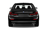 Straight rear view of 2021 BMW 5-Series 530e-Sport 4 Door Sedan Rear View  stock images