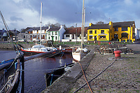 AJ0945, Europe, Republic of Ireland, Ireland, Boats docked in Kinvarra Bay in the colorful quaint town of Kinvarra in County Galway.