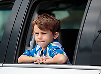 Feb 9, 2020; Pomona, CA, USA; Noah Hood, son of former funny car driver Ashley Force Hood (not pictured) sits in a tow vehicle watching the NHRA Winternationals at Auto Club Raceway at Pomona. Mandatory Credit: Mark J. Rebilas-USA TODAY Sports