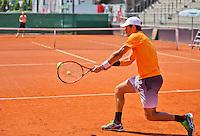 Austria, Kitzbuhel, Juli 15, 2015, Tennis, Davis Cup, Training Dutch team, Jean-Julien Rojer returns the ball to Thiemo de Bakker in the background.<br /> Photo: Tennisimages/Henk Koster