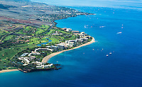 An aerial view of Ka'anapali Beach and coastline bordered by the blue Pacific Ocean, Maui.