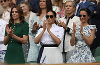 LONDON, ENGLAND - JULY 13:  Catherine, Duchess of Cambridge and Meghan, Duchess of Sussex  attend the Women's Singles Final of the Wimbledon Tennis Championships at All England Lawn Tennis and Croquet Club on July 13, 2019 in London, England<br /> <br /> <br /> People:  Catherine, Duchess of Cambridge and Meghan, Duchess of Sussex, Pippa Middleton