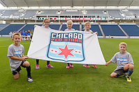 Chicago, IL - Saturday July 30, 2016: Flag bearers prior to a regular season National Women's Soccer League (NWSL) match between the Chicago Red Stars and FC Kansas City at Toyota Park.