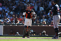 SAN FRANCISCO, CA - SEPTEMBER 19:  Buster Posey #28 of the San Francisco Giants works against the Atlanta Braves during the game at Oracle Park on Sunday, September 19, 2021 in San Francisco, California. (Photo by Brad Mangin)