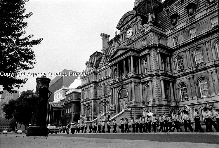 Montreal firemen walk peacefully on Montreal City Hall in August 1973 (exact date unknown),<br /> requesting a salary increase which was refused until they went on strike illegally from October 31 to November 3, 1974 resulting in over 140 buildings burned.<br /> <br /> File Photo : Agence Quebec Presse - Alain Renaud