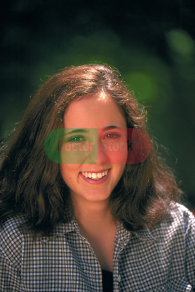 portrait of smiling teenage girl outdoors