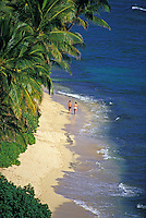 Couple strolling on secluded Diamond Head Beach, near Waikiki, Oahu